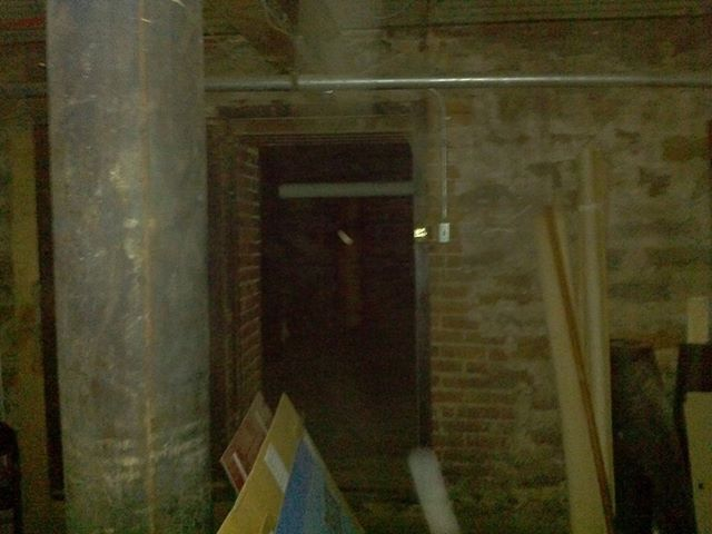 Mist figure in the middle of doorway, in the basement of the jail.
